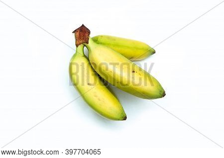A Picture Of An Usual Bunch Of Baby Bananas. They Are Small And Sweet. Good Snack For You. Isolated