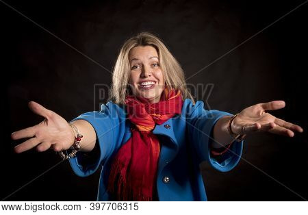 Cheerful 40 Years Old Woman In Blue Coat And Red Kerchief Welcome Gesture