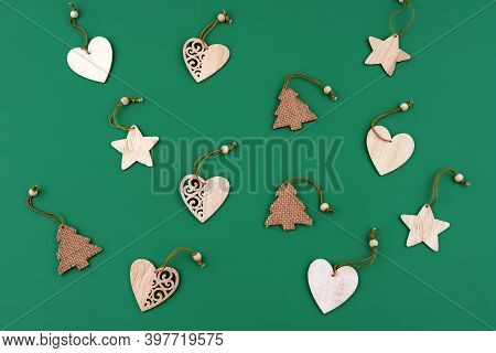 Wooden Christmas Toys For Christmas Tree Against Dark Green Background. Christmas Background, Christ