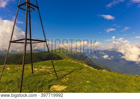 Beautiful Mountain Landscape At Caucasus Mountains With A Geodetic Sign
