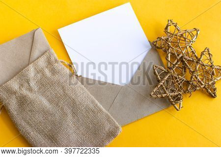 Kraft Envelope And White Sheet For Writing The Paper. Gold Stars From The Vine. An Eco-bag With Enve