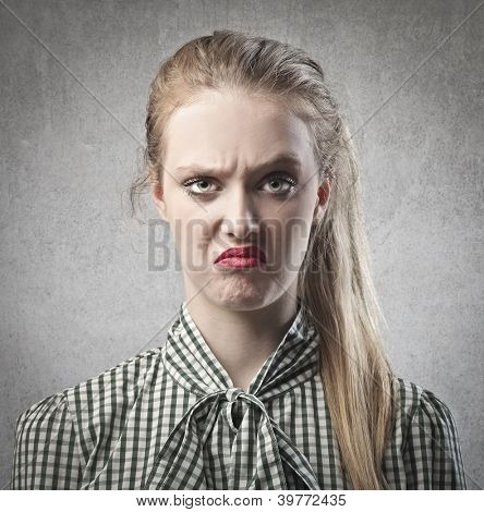 Blonde girl disgusted by something