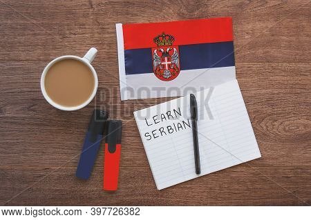 Serbian National Flag, Cup Of Coffee, Notebook With The Inscription Learn Serbian, Two Markers On Th