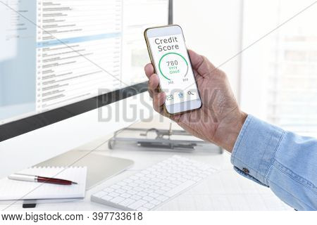 Credit Score Concept. Closeup of a man checking his score on his cell phone.