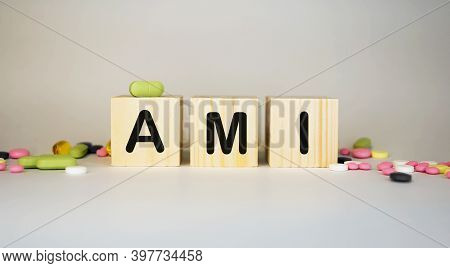 Ami Acute Myocardial Infarction - Word From Wooden Blocks With Letters On White Background Surrounde
