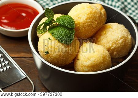 Arancini, A Dish Of Italian And Sicilian Cuisine, Balls Of Rice And Cheese With Different Fillings.c