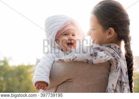 Infants, Childhood, Motherhood, Family, Lifestyle Concept - Happy Young Mom In Glasses Hold Fat Chub