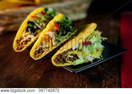 Mexican Beef Tacos Loaded With Toppings Including Olives Shredded Lettuce And Tomatoes