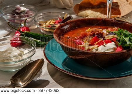 Mexican Chorizo Sausage Taco Soup With Pinto Black And Kidney Beans Served With Glass Of Red Wine
