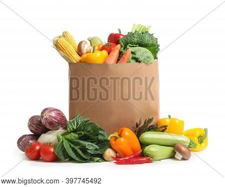 Fresh Vegetables In Paper Shopping Bag On White Background