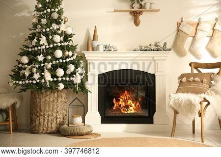 Beautiful Living Room Interior With Decorated Christmas Tree And Modern Fireplace