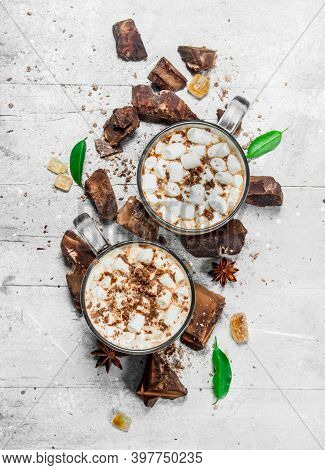 Hot Chocolate With Chunks Of Bitter Chocolate And Marshmallows. On A Rustic Background.
