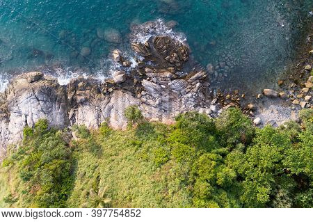 High Angle View Tropical Sea With Wave Crashing On Seashore And High Mountain Located In Phuket Thai
