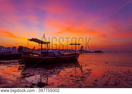 Longtail Fishing Boat In The Sea In Morning Time Sunrise Or Sunset Light With Beautiful Sunrise And