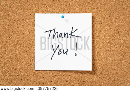 White Thank You Post Note Pinned On Corkboard