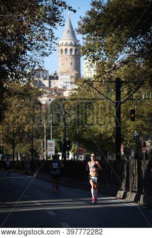 Istanbul, Turkey - November 08, 2020: Undefined Athlete Running In 42. Istanbul Marathon Which Inclu