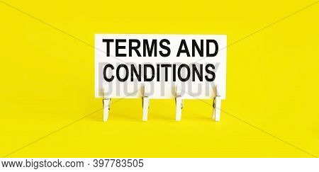 Text Terms And Conditions On The White Short Note Paper On Yellow Background