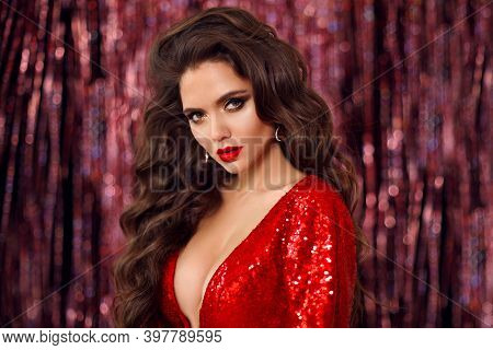 Beautiful Brunette In Red Dress With Healthy Wavy Hair. Glamour Makeup. Fashion Beauty Girl Isolated