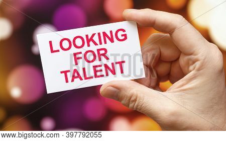 Looking For Talent- An Inscription On A Card That A Person Holds On A Background Of Fireworks