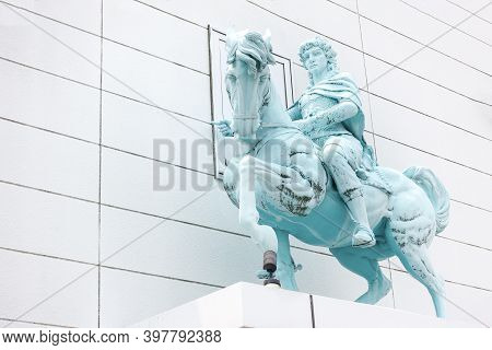Beppu, Kyushu, Japan, June 21, 2017: Sculpture Of A Rider Sitting On A Horse On The Facade Of The Bu