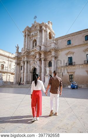 Couple Men And Woman On Citytrip, Ortigia In Syracuse Sicily Italy In The Morning. Travel Photograph
