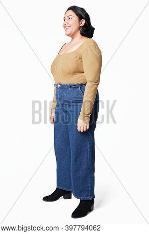 Women's top and jeans size inclusive fashion studio shot