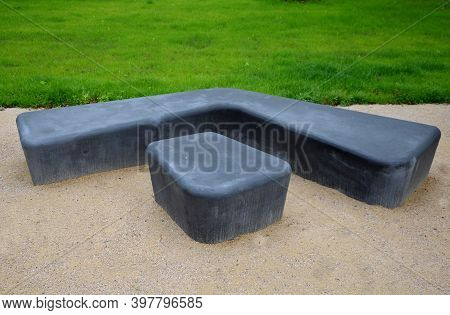Gray Monolithic Concrete Park Bench Made Of Concrete In The Shape Of Round Stones Anthracite Color P