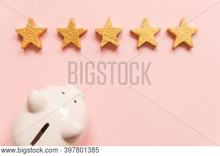 Simply Minimal Design Piggy Bank 5 Gold Stars Isolated On Pink Background. Bank Rating. Saving Inves