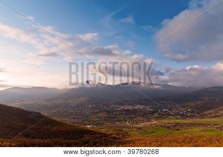 view of a town from the top of a mountain