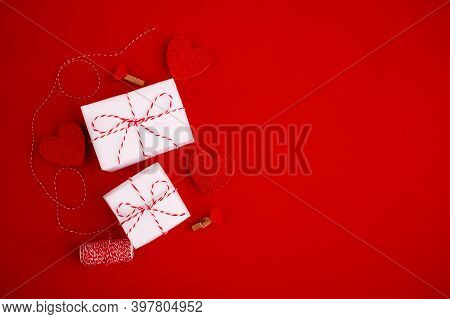 Valentine Day Greeting Card Composition.white Gift Boxes With Bow And Hearts On Red Background. Top