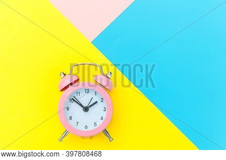 Ringing Twin Bell Classic Alarm Clock Isolated On Blue Yellow Pink Pastel Colorful Geometric Backgro
