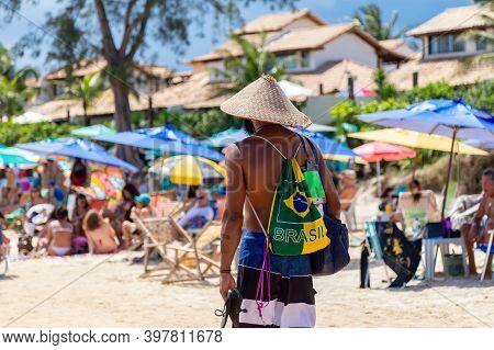 Buzios, Rio De Janeiro, Brazil - December 22, 2019: Brazilian Man Wearing A Traditional Backpack Wit