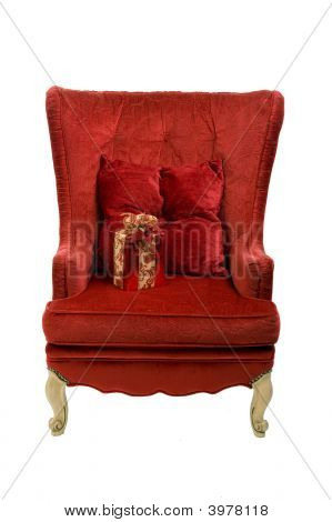 A Red Chair With Presentand Clipping Path