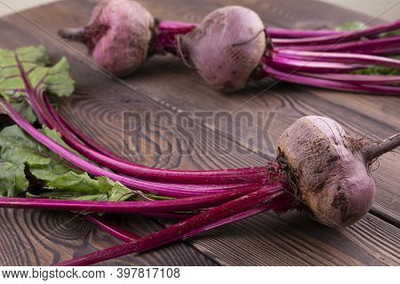 Organic Beetroot, Red Beetroot With Herbage Green Leaves On Rustic Background.
