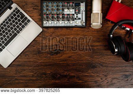 Laptop, Headphones, Mixer Console, Microphone And Sound Card.