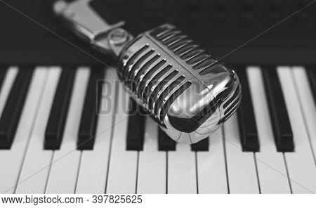 Microphone On The Piano Keyboard. Recording Studio Concept.