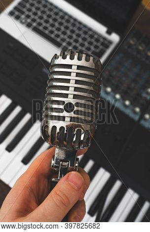Man Holding Retro Microphone In Music Studio. Ready To Sing!