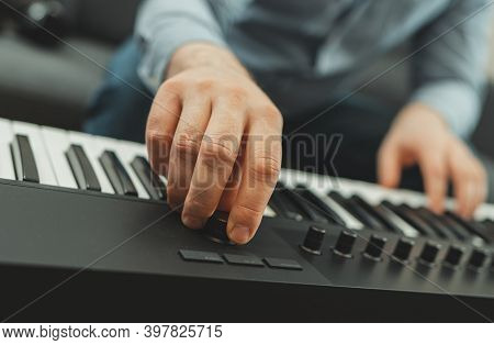Man Playing The Piano In Studio, Recording New Song.