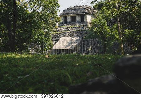 Small Pyramid Mayan Ruin Temple At The Archaeological Unesco Site Of Palenque Surrounded By Green Tr