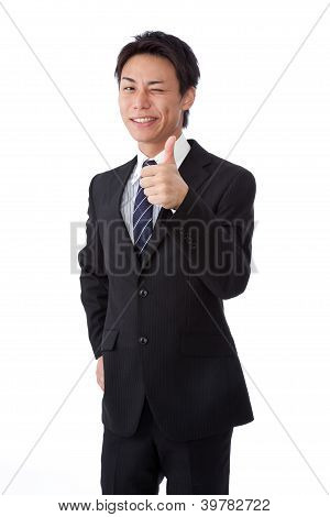Young Businessman With A Wink And Thumbs Up
