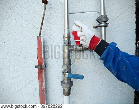 Hand Of Technician During Open Or Close Manual Ball Valve On Stainless Steel Pipeline Of Gas Flatfor