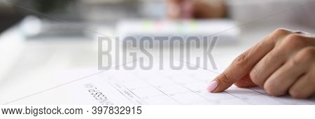 Womans Finger Indicates Date In Business Plan. Strategic Planning Of Business Tasks Concept