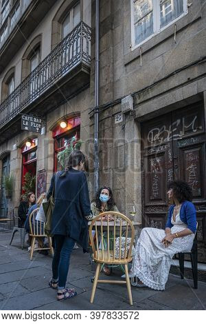 Santiago De Compostela, Spain, July 2020 - Ladies Sitting Outside A Cafe Socialising, In The City Of