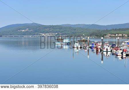Noia, Spain. September 12, 2020. Harbor And Galician Fishing Vessels With Water Reflections. Porto D