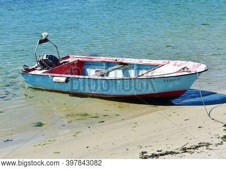 Portosin, Spain. July 3, 2020. Galician Old Wooden Motor Boat Moored On A Beach. Rias Baixas, Coruña