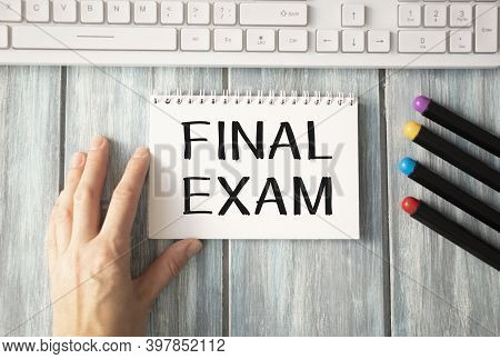 Final Exam Message On The Card Shown By A Wooman