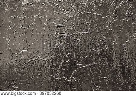 Abstract Rough Painted Glossy Black Surface For A Textured Background Or Wallpaper