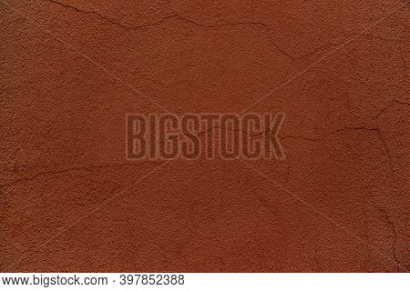 Old Plastered Wall Surface With Thin Cracks For Rough Textured Background Or Wallpaper Of Dark Terra