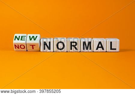 Covid-19 New Normal Symbol. Turned Cubes And Changed The Words 'not Normal' To 'new Normal'. Covid-1