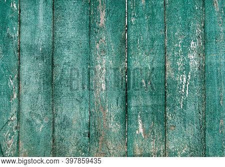 Old Shabby Barn Fence. Green Painted Wood Slats. Scratched Rustic Natural Material. Blue Weathered G